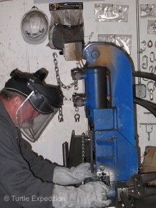 Mike Marks used special hydraulic ram to cut chain links to the desired length.