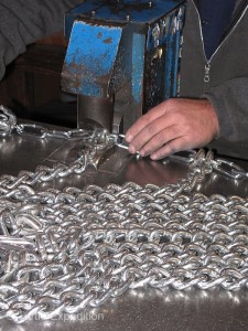 A hydraulic press makes closing the cross chain hooks much easier than using chain repair pliers.