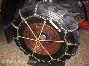 Pewag's new Multi-Arm chain tighteners are an easy way to keep chains snug on the tire.