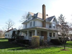 Reutter's Roost is a transitional Queen Anne style home with a Victorian wraparound porch was built in 1913.
