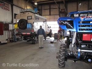 The big hydraulic floor lift at Midwest Four Wheel Drive, home of Bigfoot, had no problem lifting The Turtle V.