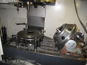Computerized CNC machines are used for precise machining of center holes and lug nut holes.