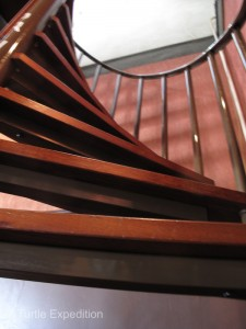 Narrow houses give rise to narrow spiral staircases. One side of these staircases becomes increasingly narrower and you really need to watch your step before it disappears.