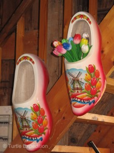 For the tourists, clogs have many uses beyond working in the farmyard.