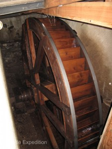 The old waterwheel under the shop still turns, but today the power comes from electric motors.