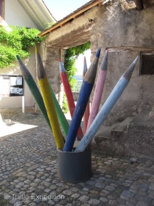 Modern art in front of the village school next to the castle.