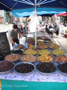 Olives galore. All one price by the scoop or kilo.