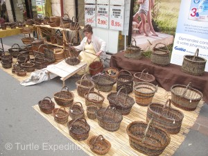 Artists like this basket weaver sell their crafts. Wish we had room to take a few home.