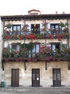 Balconies overflow with flowers.