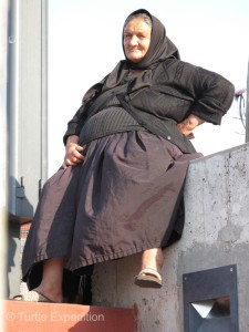 Where there are markets in Portugal, there are gypsies. This is the typical dress for an older female.