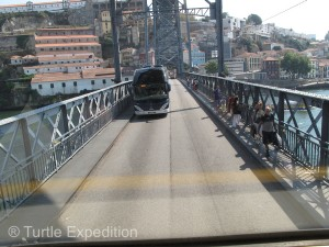 Passing a big bus on a narrow bridge can be exciting.
