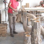 A craftsman at the Cortiçarte-Arte em Cortiça, Lda. Company hones out the center of a first-growth cork tree for use as a decorative planter or perhaps a cute lamp.