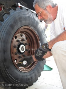 Rotating five 180-lb tires and checking the torque on the wheels and the pressures are easier in the comfort of a modern RV park.