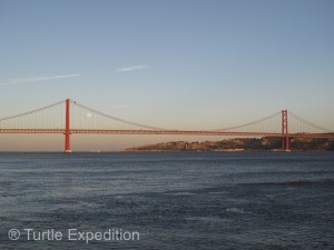 The 25th of April Bridge across the River Tejo was built in 1966 by the American Bridge Company who constructed the San Francisco-Oakland Bay Bridge, not the Golden Gate Bridge but it might explain its similarity in design.