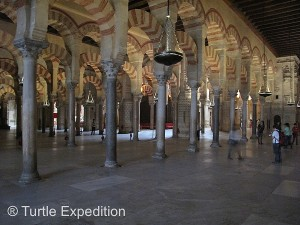 The interior of the Mezquita (Cathedral) is a forest of arches and marble pillars.
