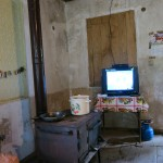 Most of their cooking and winter heat came from a wood burning stove. A modern touch: the TV was always on.