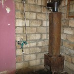 The shower was probably fed from a tank on the roof through a wood burning hot water heater. A wooden chair and a few bars of soap rounded out the facilities.