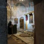 Peeking inside, we saw the monks reciting their prayers.