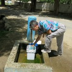 Monika takes advantage of one of the spring fed fountains in a village to finish up a mini wash.