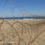 Coils of razor wire on the beaches and serious fences along coastal highways left no doubt that there was still a real threat from invading North Koreans.