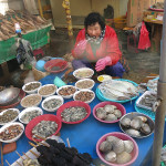 This woman was selling and eating a great selection of shucked oysters and clams along with a few skewers of abalone ready for the grill.