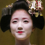 Various hairstyles and decorations change as a geisha continues her training and grows to maturity.