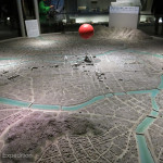This model shows the city of Hiroshima and the red fire ball indicates the location where the A-bomb was dropped.