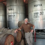 50,804 liters of tequila. If a single shot glass is 44mL (1.5 US fl oz), then one of the tanks behind me can make 572,633 margaritas.