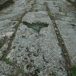 Massive slabs of stone had been cut and placed like a puzzle to pave the main streets of Dion.
