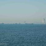 Oil tankers and cargo vessels wait their turn to pass through the narrow Bosporus Strait.