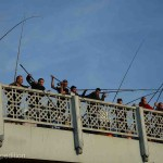 Crowds of fishermen dangled their lines over the edge of the Galata Bridge to catch the ebbing tide.