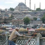 Fishermen on the Galata Bridge have a nice view of the famous Süleymaniye Mosque in the distance.