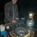 In the evening, several vendors arrived including this gentleman selling fresh roasted chestnuts.