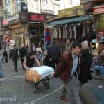 Surrounding the Grand Bazaar, commercial streets are busy with men hauling goods to the various shops.