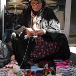 Some women vendors kept busy with handicrafts.
