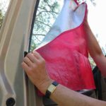 Homemade lightweight window covers from Space Blanket material attach easily with Velcro tabs.