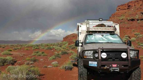 After the 2015 Overland Expo in Arizona we camped with friends at Valley of the Gods when a sudden rain squall/storm swooped over us and then surprised us with a double rainbow. To keep the heat (and sometimes eyes) out of the cab, we always cover the windows on the inside.