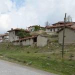 The village of Beyazaltin was poor. Buildings showed their age as rock walls crumpled.
