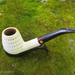 This intricately carved pipe has an outer layer of tiny holes, kind of a shell around the inner core, that would take all the advantages of the meerschaum's attributes for a cool, dry smoke.