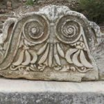 A detailed carving. Is it representing an owl?