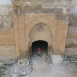 Gary is inspecting the inside   of the Hoca Mesut Caravanserai's arched entry tower.