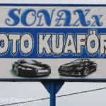 Oto=auto and Kuaför is the phonetic spelling of Coiffeur, the French word for hair dresser. So what are they advertising? A car wash? A car detailing shop?