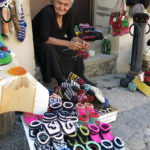 We chatted with friendly ladies sitting at their doorsteps busily knitting and displaying their felted handicrafts.