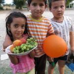 We had just parked when this young girl, her brother and his friend arrived to welcome us with a bowl of fruit.