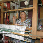 Though some of the weaving is done on machines much of the beautiful silk patterns are still woven on the old fashion handlooms.