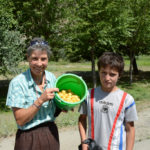 We bought a half a bucket of ripe apricots from kids on the side of the road.