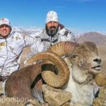 Hunters posing with their Marco Polo Bighorn Sheep trophy. Photo from the internet.