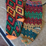 These tradition socks are called jurab. The artisans use a slip stitch crochet method with a very different hook than ours.