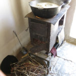 During our visit, the women's hands were busy and the soup was cooking on the stove.
