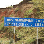 Another road sign. Yes, we were going downhill. 2,389 m/7,837 ft.